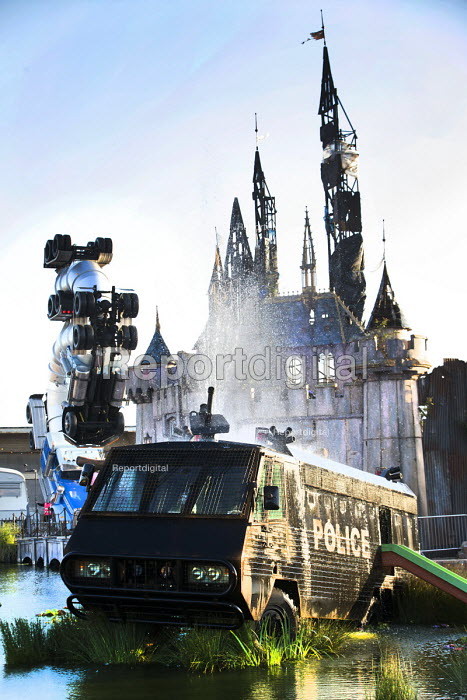 Dismaland a parody of Disneyland theme park by Banksy, Weston Super Mare. Police vehicle, fairytale castle Big Rig Jig, an artwork by Mike Ross at the Bemusement Park. - Paul Box - 2015-08-27