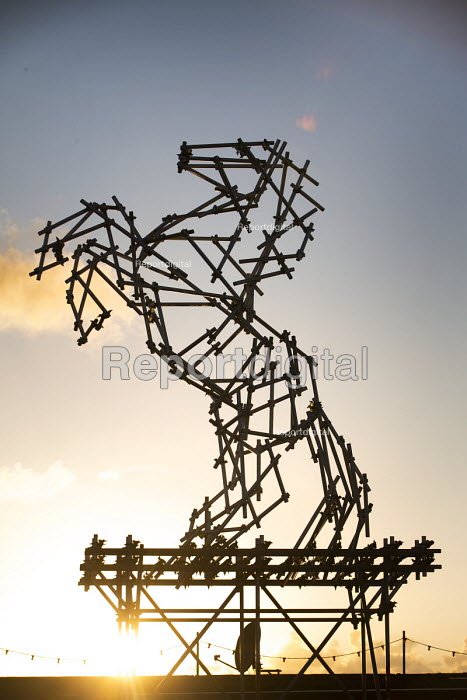 Dismaland a parody of Disneyland theme park by Banksy, Weston Super Mare. Stallion constructed from used scaffolding by Ben Long at the Bemusement Park. - Paul Box - 2015-08-27