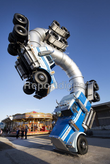 Dismaland a parody of Disneyland theme park by Banksy, Weston Super Mare. Big Rig Jig, two juggernauts performing ballet, an artwork by Mike Ross at the Bemusement Park. - Paul Box - 2015-08-27