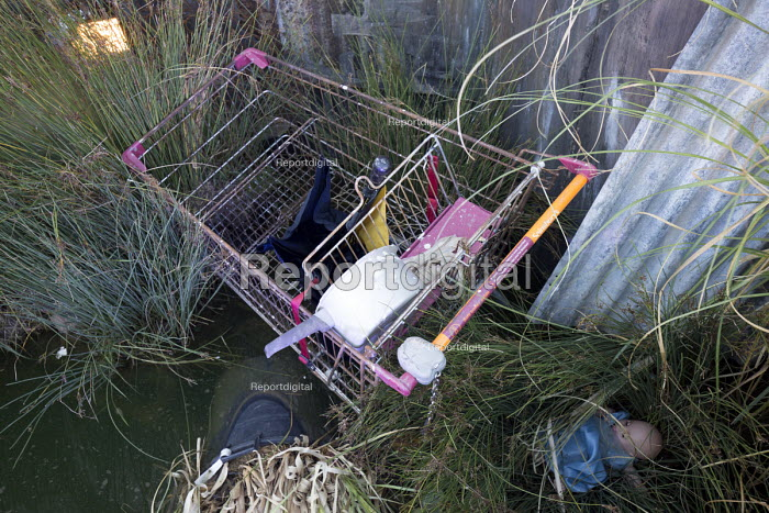 Dismaland a parody of Disneyland theme park by Banksy, Weston Super Mare. Discarded shopping trolly Bemusement Park. - Paul Box - 2015-08-27