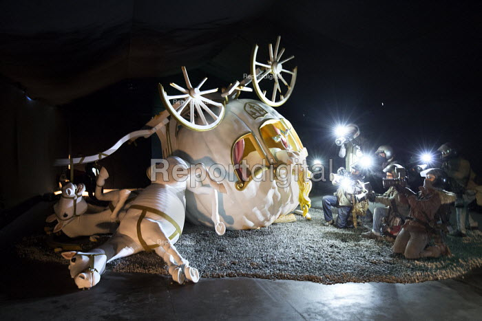 Dismaland a parody of Disneyland theme park by Banksy, Weston Super Mare. Disney princess Cinderella horse drawn pumpkin carriage coach crash with paparazzi press photographers in motorcycle helmets, refering to death of Princess Diana by Banksy at the Bemusement Park. - Paul Box - 2015-08-27