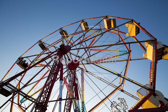 Dismaland a parody of Disneyland theme park by Banksy, Weston Super Mare. Ferris wheel at the Bemusement Park. - Paul Box - 2015-08-27