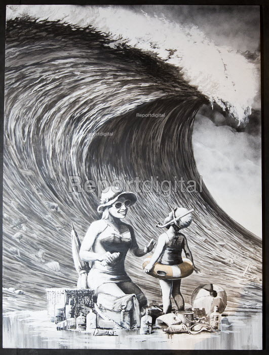 Dismaland a parody of Disneyland theme park by Banksy, Weston Super Mare. Big wave about to engulf a family on a beech, painting by Banksy at the Bemusement Park. - Paul Box - 2015-08-27