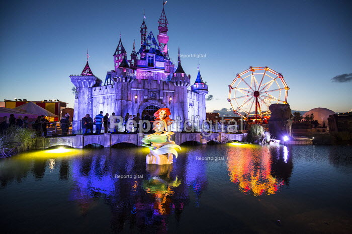 Dismaland a parody of Disneyland theme park by Banksy, Weston Super Mare. Mermaid and fairytale castle at the Bemusement Park. - Paul Box - 2015-08-27