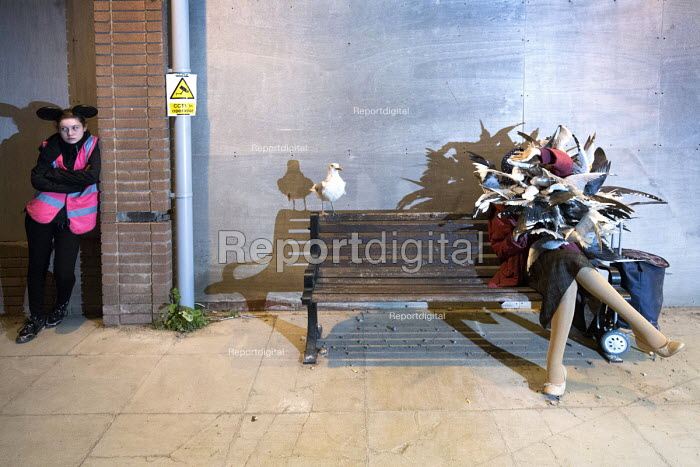 Dismaland a parody of Disneyland theme park by Banksy, Weston Super Mare. Seagull attack at the Bemusement Park staffed by morose Dismaland guides who are uninterested in being helpful or remotely informative. - Paul Box - 2015-08-27