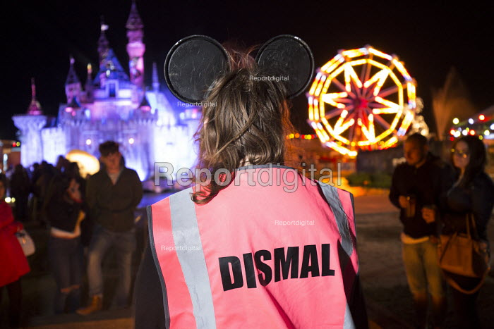 Dismaland a parody of Disneyland theme park by Banksy, Weston Super Mare. A Bemusement Park staffed by morose Dismaland guides who are uninterested in being helpful or remotely informative and Dismal Tabbard - Paul Box - 2015-08-27