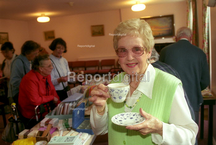 A happy oap with a cup of tea at her retirement home, Bristol - Paul Box - 2003-12-01