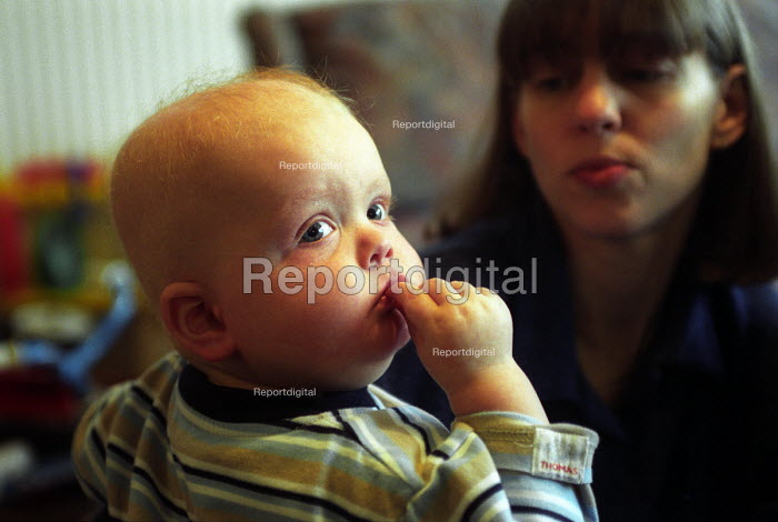 A young child who has Leukaemia, with his mother in the background. - Paul Box - 2001-12-01