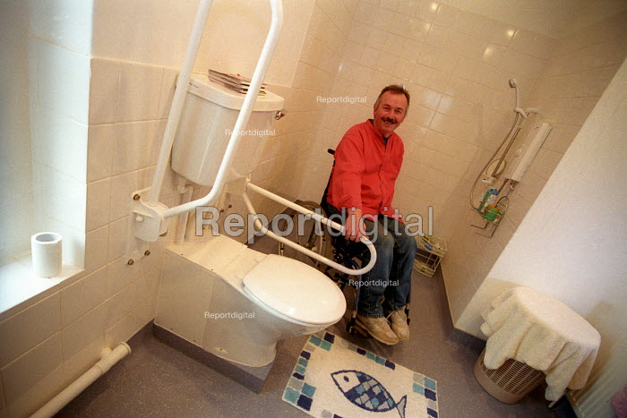 A disabled man at his home adapted by a housing charity for his special needs, Minehead. - Paul Box - 2003-12-01