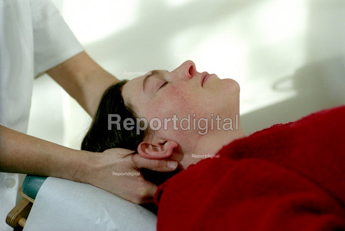 A patient visits a chiropractor for a back massage, Bristol - Paul Box - 2003-12-01