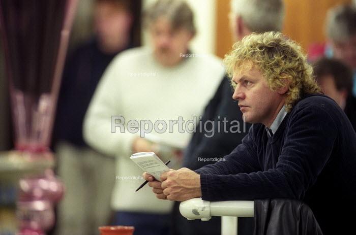 An Auction house Bath , a dealer looks on. - Paul Box - 2003-11-01