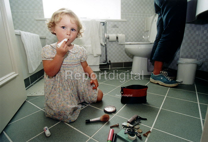 Girl playing with makeup in the bathroom at home. - Paul Box - 2004-01-26