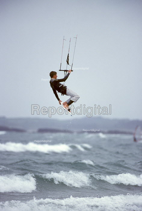 Kite surfer above the waves. - Paul Box - 2003-07-18