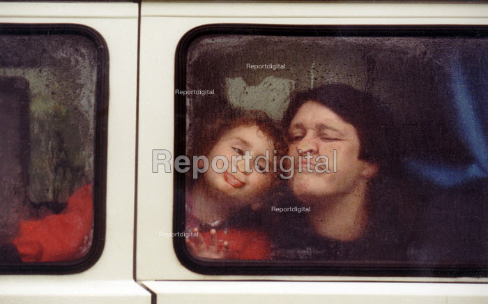 Making faces against the window of the camper van in the rain. - Paul Box - 2003-04-26