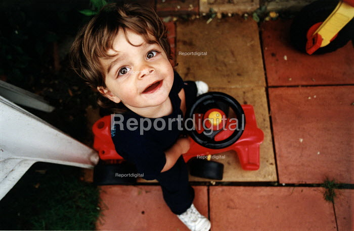 Boy playing on his toy car. - Paul Box, PB401q29.jpg