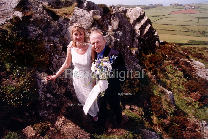 Bride and Groom on their wedding day, in the Pembrokeshire countryside. - Paul Box - 2002-06-26