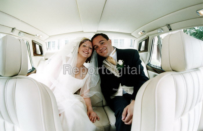 Bride and Groom on their way from their wedding. - Paul Box - 2000-07-14