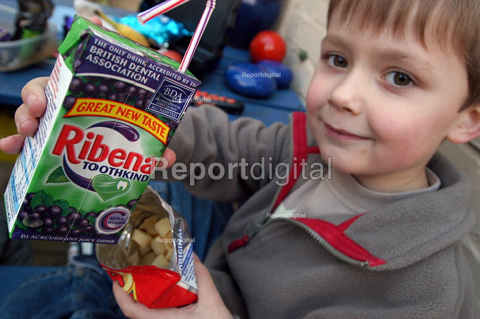 A young boy eats his packed lunch - Paul Box - 2004-02-17
