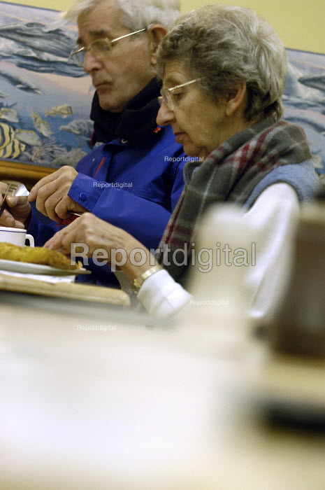 an elderly couple eats fish and chips in a cafe in Tenby - Paul Box - 2004-01-20