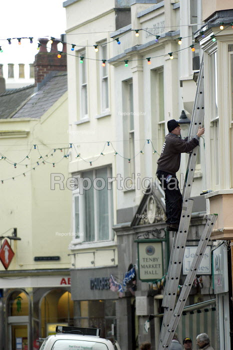 Window cleaners at work, Tenby, Pembrokeshire , Wales - Paul Box - 2004-01-21