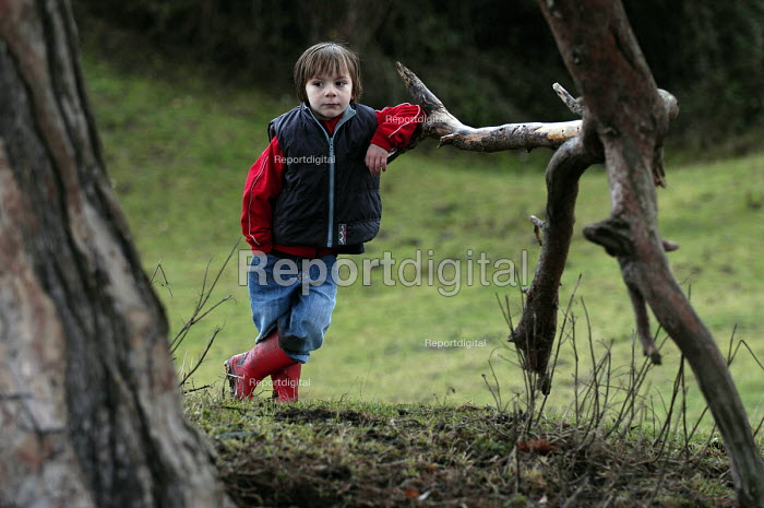 A young boy poses for a photograph - Paul Box - 2003-01-20