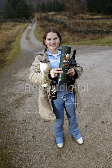 A young woman carries her dads whiskey - Paul Box - 2004-01-01