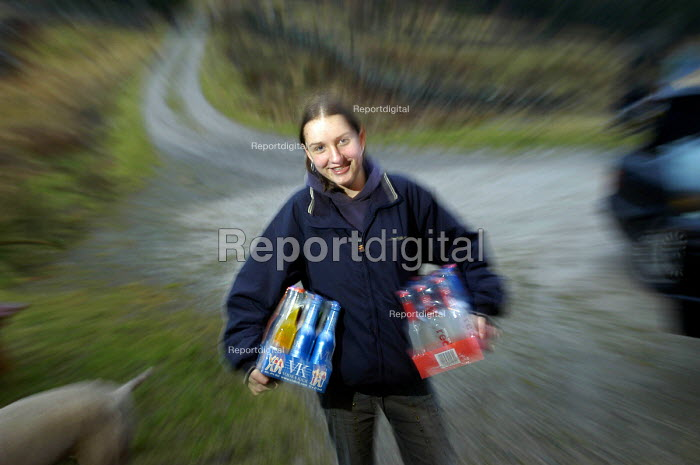 A teenage girl with her cases of alco pops for a party. - Paul Box - 2004-01-01