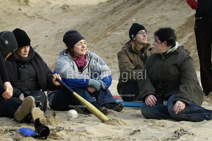 A group of young women relax on the beach on a wintery day - Paul Box - 2004-01-01
