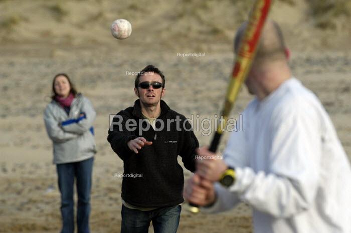 adults play soft ball on beach , Wales - Paul Box - 2004-01-01