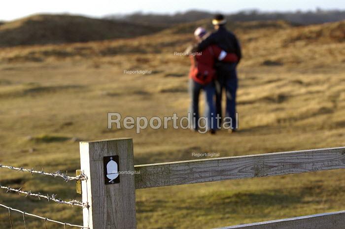 Walkers on coastal path, Pembrokeshire , Wales - Paul Box - 2004-01-11