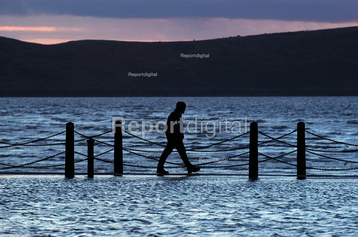 A man walking on the coast at Weston Super Mare - Paul Box - 2004-01-20