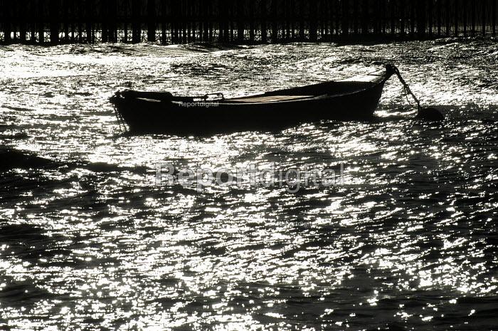 Weston super mare , small boat by pier - Paul Box - 2004-01-10