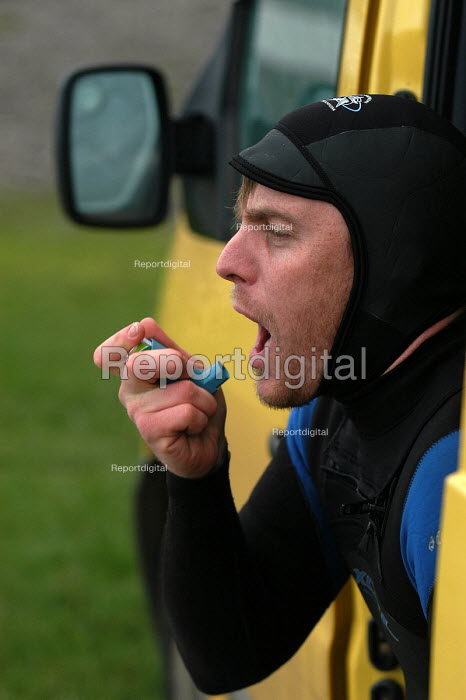 Surfer using an inhaler before going surfing for his asthma - Paul Box - 2004-01-20