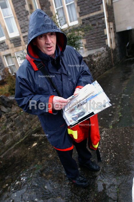 A postman on his rounds. Delivering post in Weston Super Mare - Paul Box - 2004-02-19