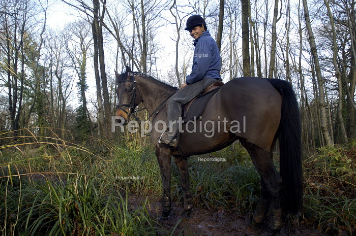 A female horse rider in the woods - Paul Box - 2004-01-01