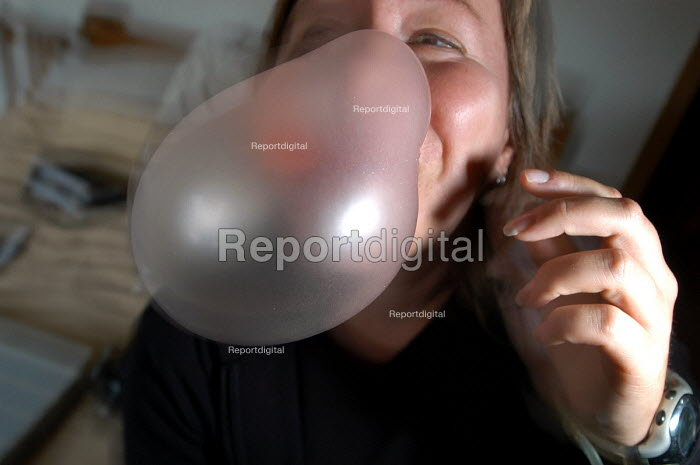 Woman blowing up a balloon, Christmas day - Paul Box - 2003-12-24