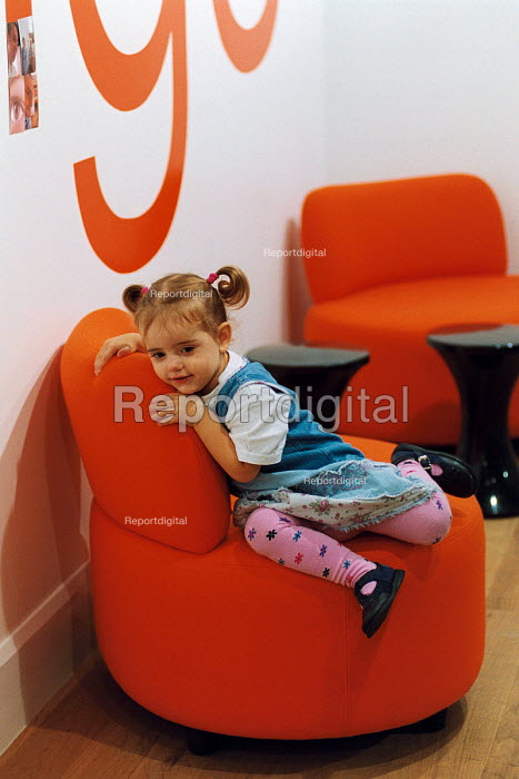 A young girl in The Orange flagship store in The Birmingham Bull Ring Centre. - Paul Box - 2003-11-01