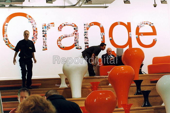 An Orange store worker in their flagship store in The Birmingham Bull Ring - Paul Box - 2003-11-01