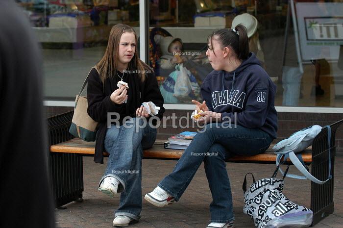 Teenage girls eat snacks in a shopping centre, Yate, nr Bristol - Paul Box - 2004-02-02