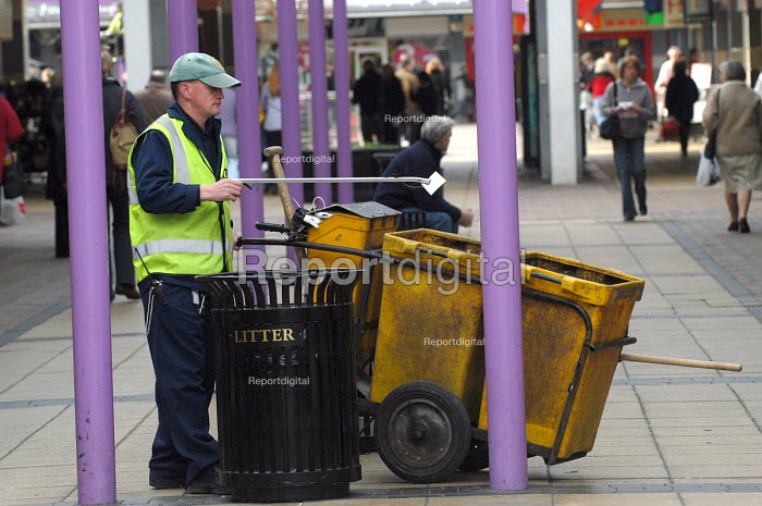 A street cleaner at work in Yate shopping centre, south Gloucestershire - Paul Box - 2004-02-02