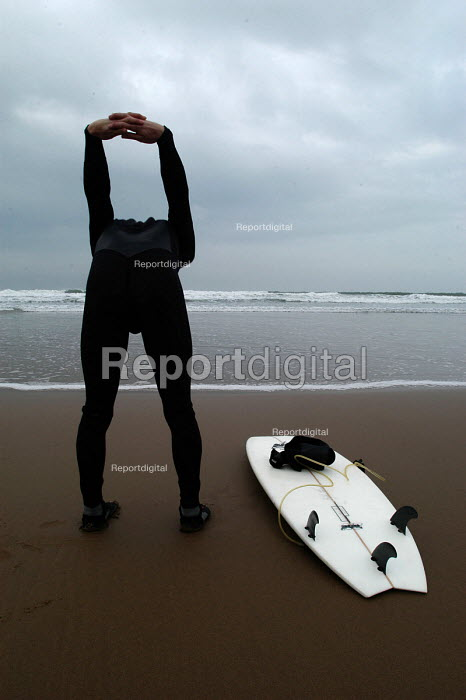 A surfer stretches before going surfing - Paul Box - 2004-01-20