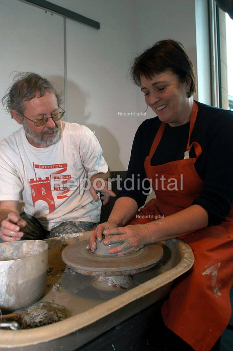 A female employee from Orange has a go at pottery on a fun day for staff. - Paul Box - 2004-02-02