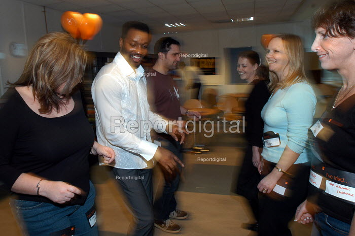 Employees from Orange have a go at Salsa dancing on a fun day for staff. - Paul Box - 2004-02-02