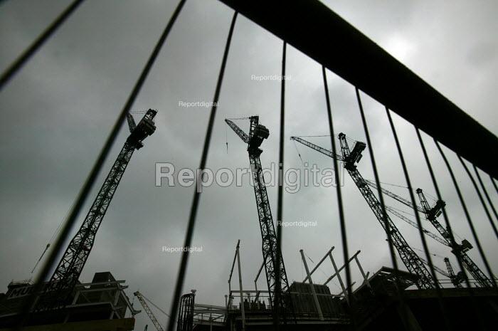 Construction of the new Wembley Stadium, London. Cranes and perimeter fence - Paul Box - 2004-04-28