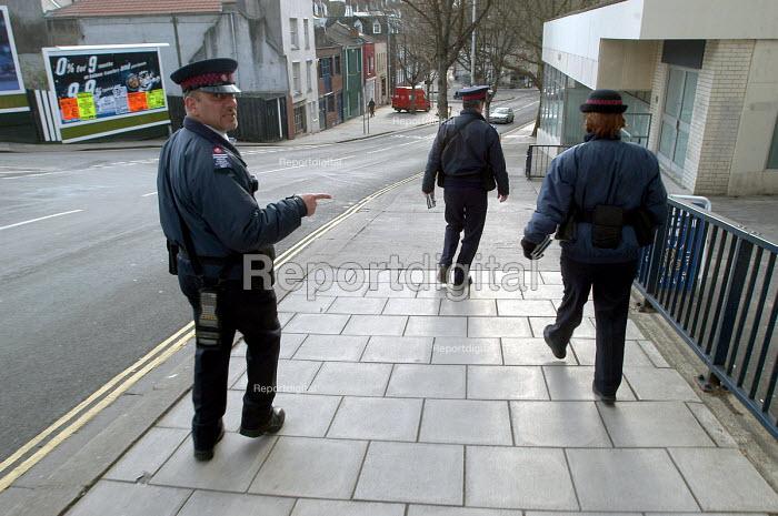 Parking attendants walking to have a tea break , Bristol - Paul Box - 2004-03-03