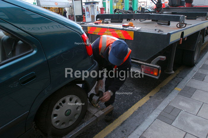 A tow truck removes a car from a clearway bus route, Bristol - Paul Box - 2004-03-03