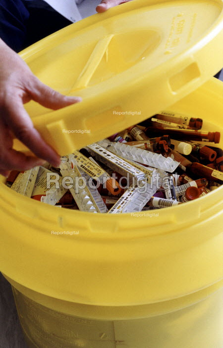 A box of sharps in safety container, ready for disposal at the Nuffield Hospital, Bristol. - Paul Box - 2003-11-01