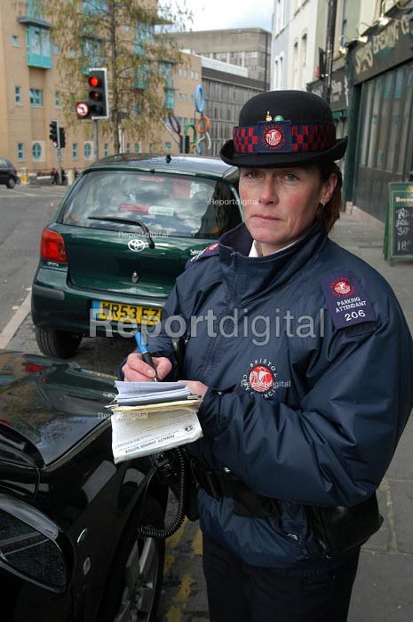 Female parking attendant , Bristol - Paul Box - 2004-03-03