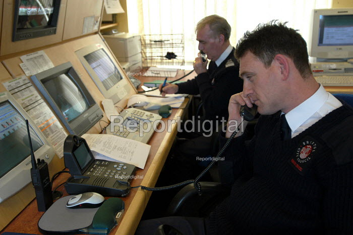 Parking attendants in the control room at parking services centre, Bristol - Paul Box - 2004-03-03