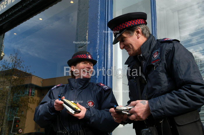 Parking attendants share a joke, Bristol - Paul Box - 2004-03-03